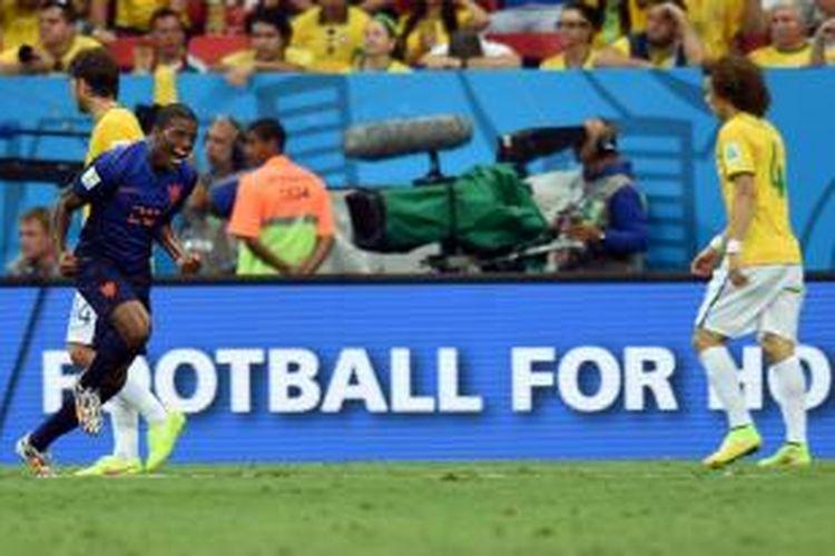 Gelandang Belanda, Georginio Wijnaldum, seusai mencetak gol ke gawang Brasil dalam perebutan tempat ketiga Piala Dunia 2014 di Estadio Nacional, Brasilia, Sabtu (12/7/2014).