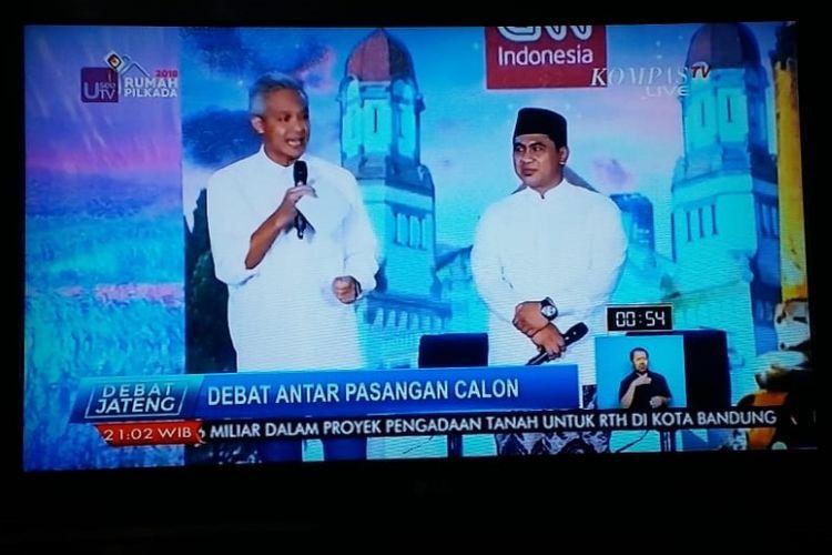 Pasangan calon gubernur dan calon wakil gubernur Jawa Tengah nomor urut 1, Ganjar Pranowo-Taj Yasin, saat tampil dalam debat perdana Pilkada Jateng di Hotel Patra, Semarang, Jumat (20/4/2018).