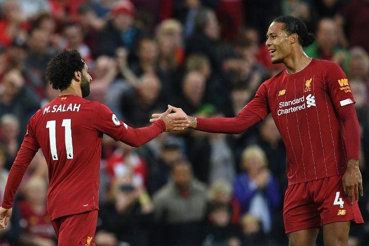 Mohamed Salah dan Virgil van Dijk merayakan gol timnya pada pertandingan Liverpool vs Norwich City di Stadion Anfield dalam pekan pertama Liga Inggris 2019-2020, 9 Agustus 2019.