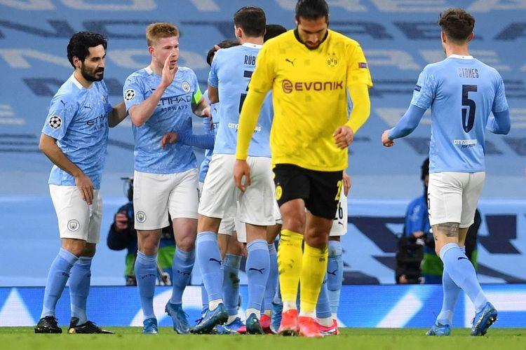 Hasil Liga Champions Rabu (7/4/2021) mempertemukan Manchester City vs Borussia Dortmund di leg pertama babak perempat final. Kevin De Bruyne merayakan golnya pada laga tersebut.