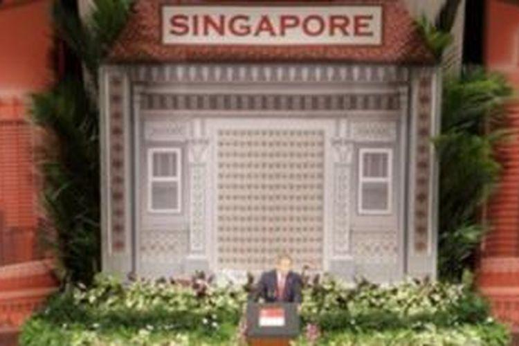 Mantan presiden AS George W. Bush saat berpidato di kampus National University of Singapore in Singapore, 2006.