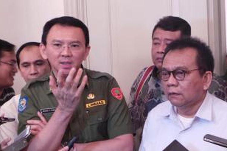 Gubernur DKI Jakarta Basuki Tjahaja Purnama setelah bertemu Wakil Ketua DPRD DKI Mohamad Taufik, di Balai Kota, Senin (14/12/2015).