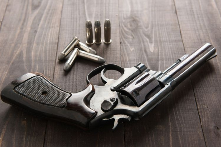 A revolver and its bullets