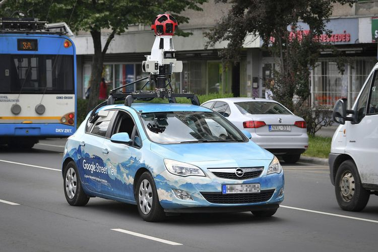 epa06747279 A photography apparatus carried on the roof of a car takes photos to update Google Street View functions in Debrecen, 226 kms east of Budapest, Hungary, 18 May 2018. Google Street View, which displays panoramas of stitched images, is a technology featured in Google Maps and Google Earth that provides panoramic views from positions along many streets in the world. The application has been updated several times in Hungary since 2013, the year it was made available in the country.  EPA-EFE/ZSOLT CZEGLEDI HUNGARY OUT