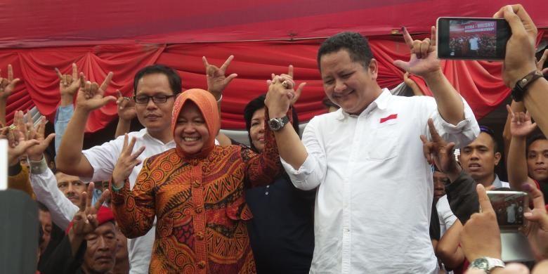 Pasangan calon Wali Kota dan Wakil Wali Kota Surabaya Tri Rismaharini dan Whisnu Sakti Buana mendatangi posko pemenangan di Jalan Kapuas 68, Surabaya, Rabu (9/12/2015).