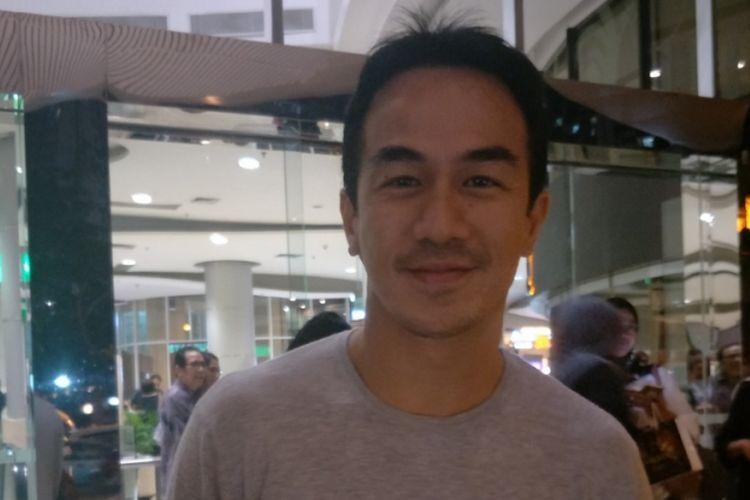 Joe Taslim menghadiri gala premiere film Chrisye di Epicentrum Walk XXI, Kuningan, Jakarta Selatan, Jumat (1/12/2017) malam.