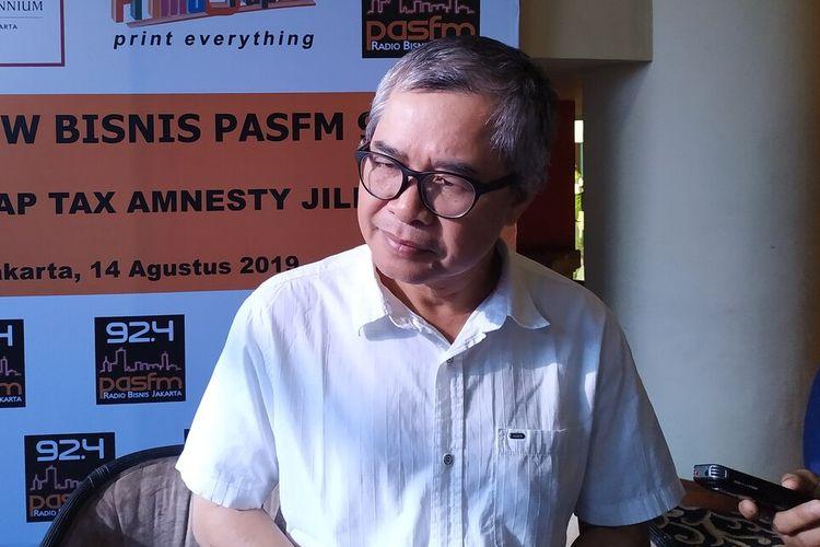 Direktur Riset Centre of Economic Reform (CORE) Piter Abdullah menyampaikan pendapatnya terkait adanya wacana Tax Amnesty jilid II dalam sebuah diskusi di Jakarta, Rabu (14/8/2019).