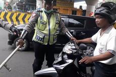 Merokok Sambil Naik Motor Didenda Rp 750.000, Ini Aturannya