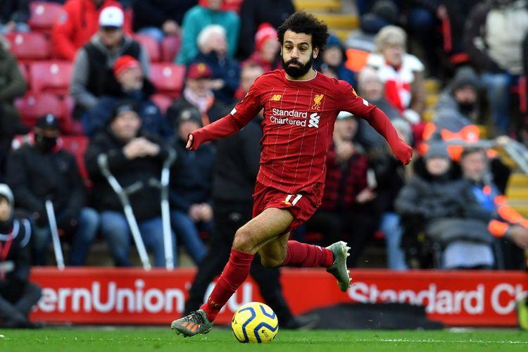 Penyerang Liverpool, Mohamed Salah, beraksi saat melawan Watford di Stadion Anfield, Sabtu (14/12/2019).