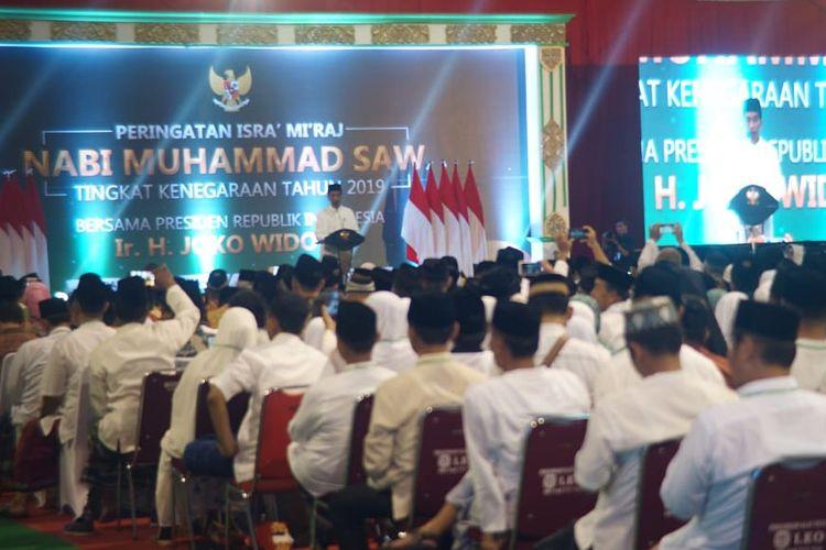 Presiden Jokowi saat menyampaikan sambutan dalam Peringatan Isra Miraj di GOR Pandawa Solo Baru, Kecamatan Grogol, Kabupaten Sukoharjo, Rabu ( 3/4/2019) malam.