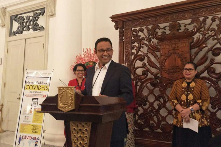 Gubernur DKI Jakarta Anies Baswedan dalam konferensi pers di Balai Kota DKI Jakarta, Jumat (13/3/2020).