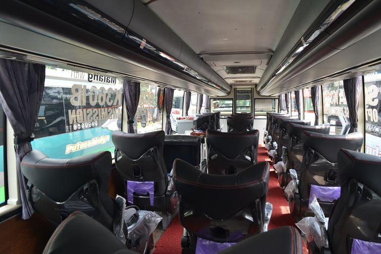 Tampak belakang kursi penumpang bus PO Putera Mulya Individual Executive Class.