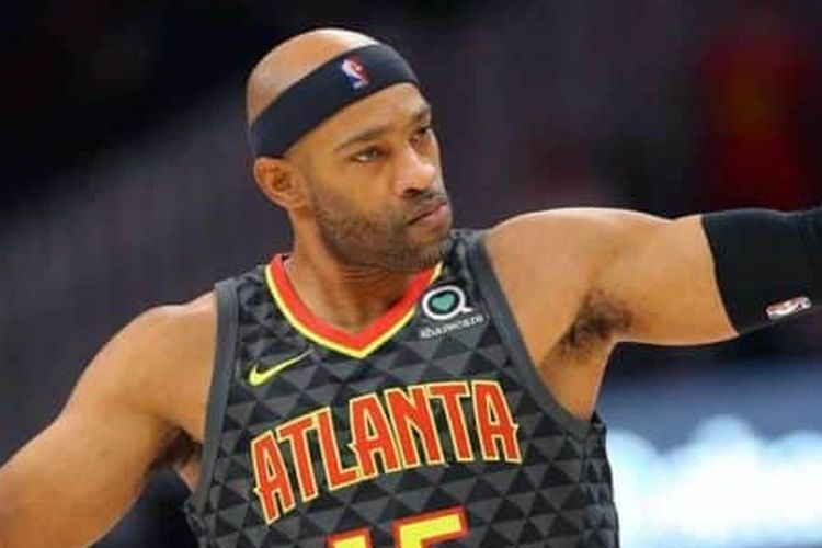 Atlanta Hawks forward Vince Carter reacts after making a three-point basket during the first half of an NBA basketball game against the Utah Jazz, Thursday, March 21, 2019, in Atlanta