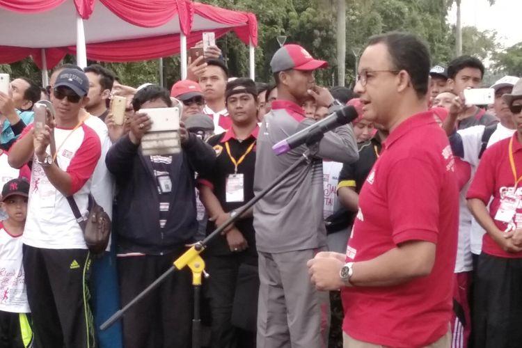 Gubernur DKI Jakarta Anies Baswedan di Monas, Minggu (25/3/2018)