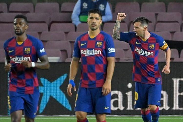 Selebrasi Lionel Messi setelah mencetak gol via titik putih dalam laga Barcelona vs Atletico Madrid pada lanjutan pekan ke-33 Liga Spanyol di Stadion Camp Nou, Rabu (1/7/2020) dini hari WIB.