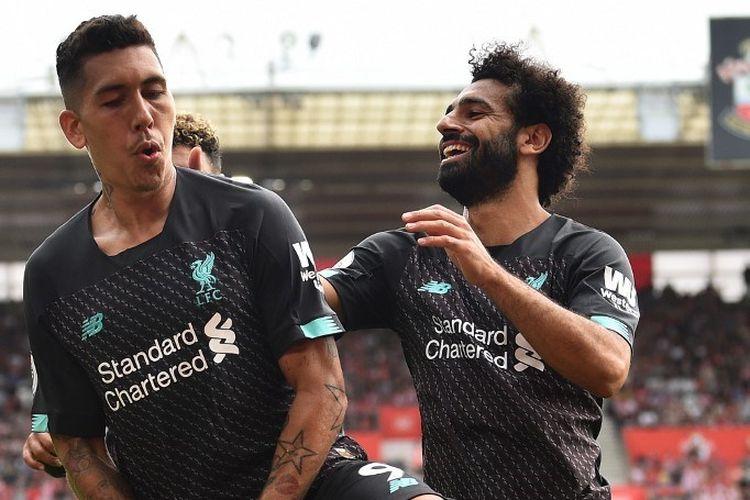 Mohamed Salah merayakan gol Roberto Firmino pada pertandingan Southampton vs Liverpool di Stadion St. Marys dalam lanjutan Liga Inggris, 17 Agustus 2019.