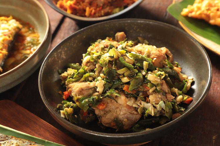 Ilustrasi ayam woku khas Manado.
