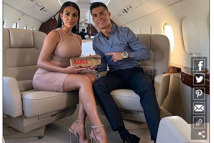Cristiano Ronaldo bersama kekasihnya, Georgina Rodriguez.