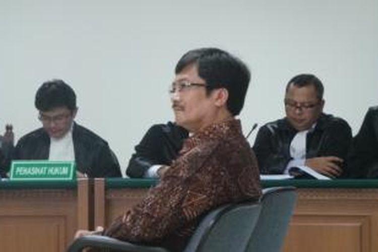 Mantan Kepala SKK Migas Rudi Rubiandini menjalani sidang perdana di Pengadilan Tindak Pidana Korupsi, Jakarta, Selasa (7/1/2014).
