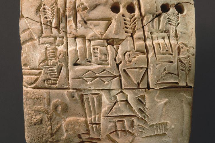 Huruf Paku atau cuneiform, tulisan bangsa Sumeria.