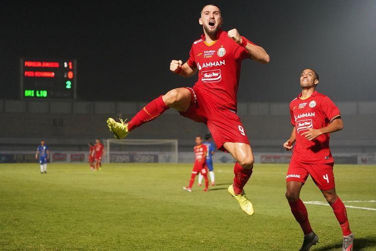 Selebrasi Marko Simic usai mencetak gol kedua Persija Jakarta dalam pertandingan melawan PSIS Semarang di Indomilk Arena, Minggu (12/9/2021) malam WIB.