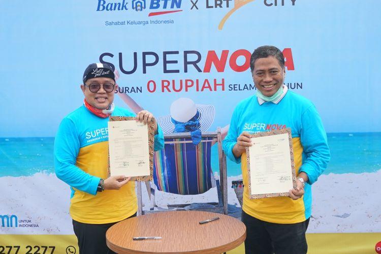 Direktur Utama PT Adhi Commuter Properti Rizkan Firman Commercial & Consumer Banking Director Bank BTN Hirwandi Gafar menandatangani perjanjian kerja sama pembiayaan KPA LRT City Jabodetabek, Supernova, Sabtu (7 November 2020).