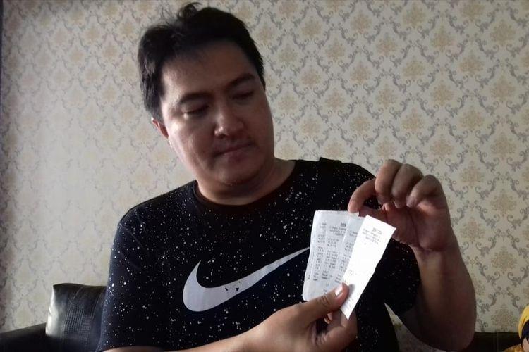 Pemilik Warung Makan Bebek Ciphuk, Riski Riswandi saat melapor ke Polres Malang Kota karena jadi korban order fiktif GrabFood, Rabu (31/7/2019)