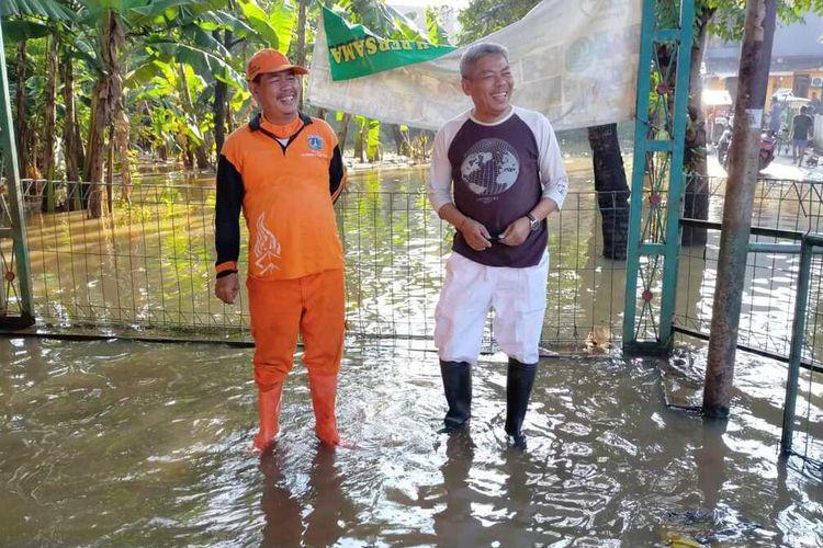 Banjiri di RW 03 dan 04, Kelurahan Cipinang Melayu, Makasar, Jakarta Timur, mulai surut, Selasa (17/3/2020).