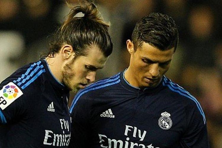 Gareth Bale dan Cristiano Ronaldo gagal mengantarkan Real Madrid menang di kandang Valencia, Minggu (3/1/2016).