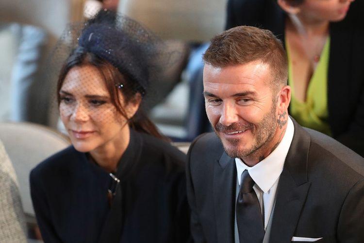 David dan Victoria Beckham menghadiri upacara pernikahan Pangeran Harry dengan Meghan Markle di  St Georges Chapel, Windsor Castle, di Windsor, pada 19 Mei 2018.
