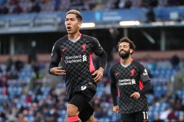 Pemain Liverpool, Roberto Firmino, merayakan golnya dalam pertandingan Burnley vs Liverpool pada pekan ke-37 Liga Inggris di Stadion Turf Moor, Kamis (20/5/2021) dini hari WIB.
