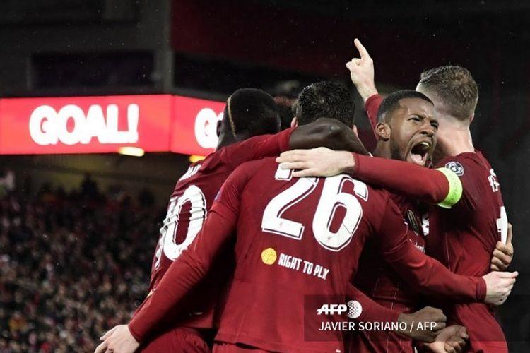 Georginio Wijnaldum dan para pemain Liverpool merayakan golnya ke gawang Atletico Madrid, Kamis (12/3/2020 dini hari WIB.
