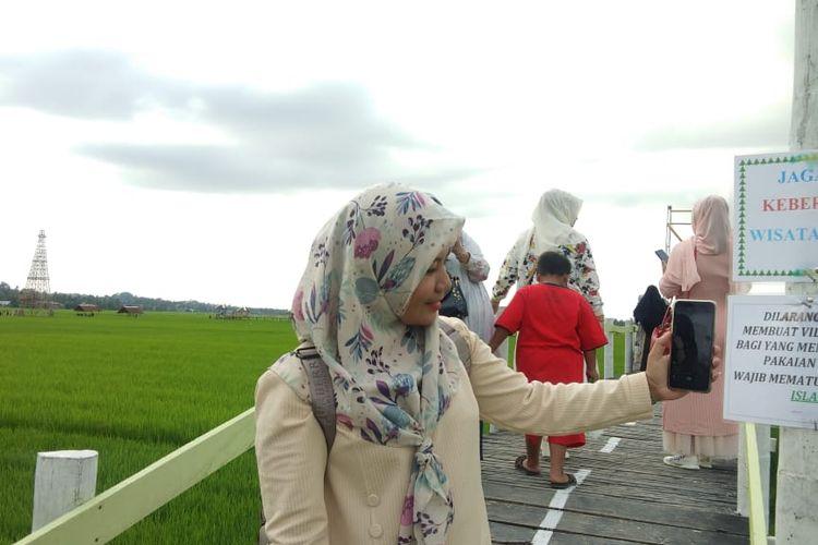 Wisata sawah di Desa Mane Kareung, Kecamatan Blang Mangat, Kota Lhokseumawe, Sabtu (26/7/2020).