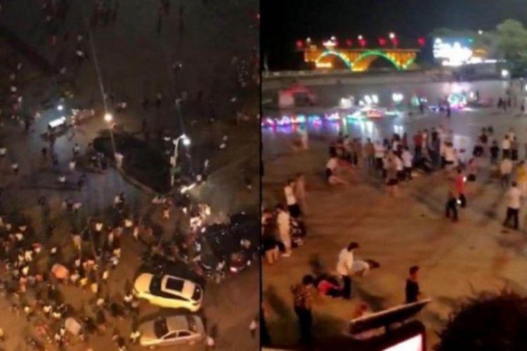 Warga panik setelah mobil menabrak kerumunan warga di alun-alun Binjiang, kota Hengyang, provinsi Hunan, China. Insiden itu menewaskan 9 orang. (Apple Daily via Straits Times)