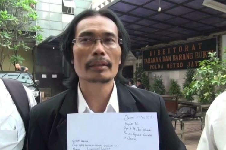 Kuasa hukum HS, Sugiarto Atmowijoyo di Polda Metro Jaya, Selasa (21/5/2019).