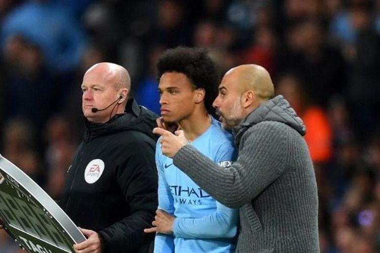 Leroy Sane dan Pep Guardiola kala masih bersama-sama di Manchester City.