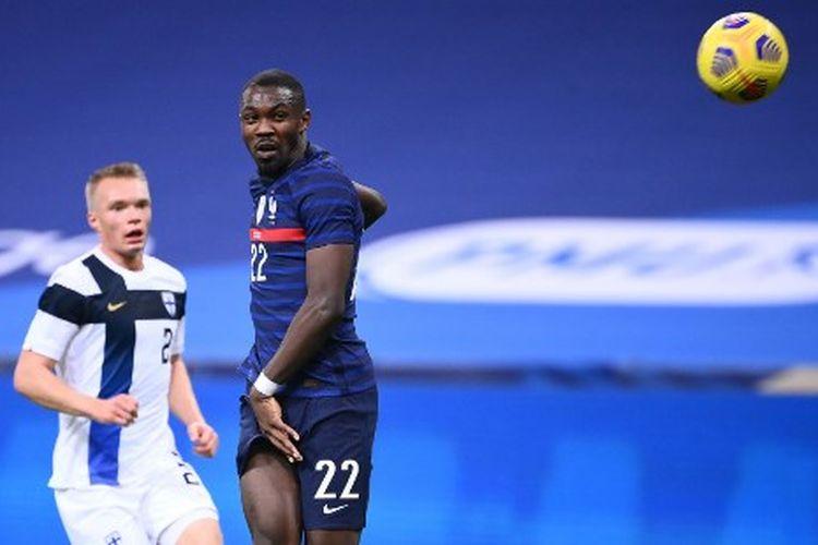 Marcus Thuram (kanan) pada laga uji coba internasional yang mempertemukan Perancis vs Finlandia di Stade de France, Kamis (12/11/2020) dini hari WIB.