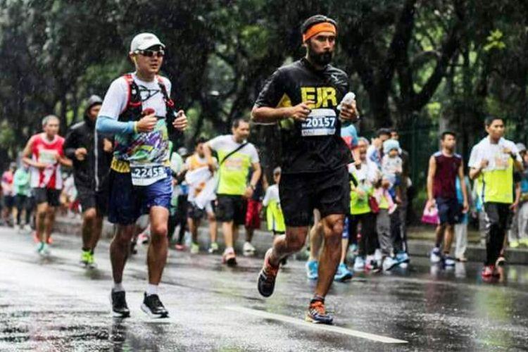 Todi Pandapotan Hasibuan sedang mengikuti lomba lari