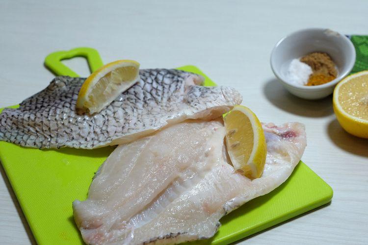 Ilustrasi ikan gurami filet siap goreng.