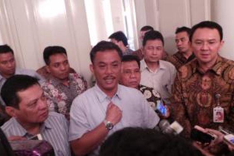 Gubernur DKI Jakarta Basuki Tjahaja Purnama (kanan) bersama Ketua DPRD DKI Prasetio Edi Marsudi (kiri), di Balai Kota, Kamis (19/3/2015).