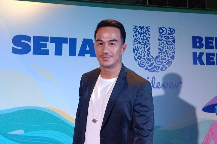 Joe Taslim berpose dalam sebuah acara di KAUM Jakarta, Thamrin, Senin (22/7/2019).