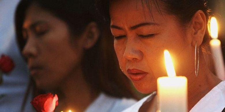 Aksi doa bersama memperingati korban serangan Bom Bali II (3 Oktober 2005). Serangan bom ini menewaskan 26 orang.