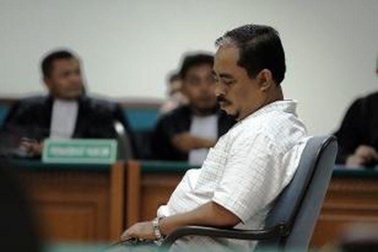 Terdakwa Luthfi Hasan Ishaaq menjalani sidang vonis kasusnya yang digelar di Pengadilan Tindak Pidana Korupsi Jakarta, Senin (9/12/2013).