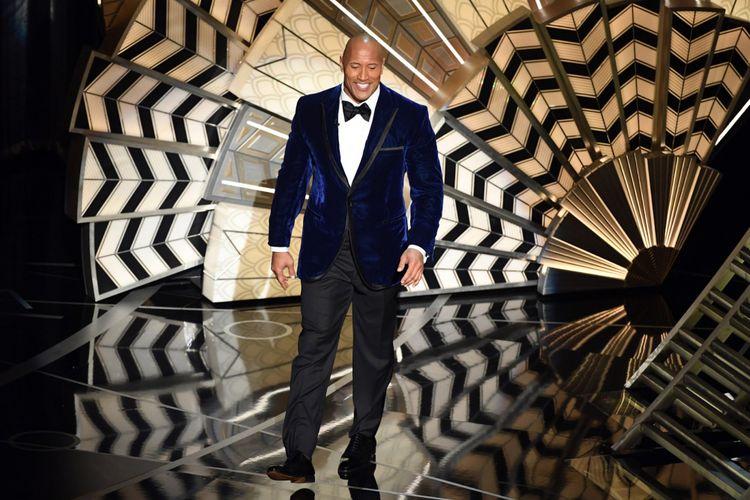 Aktor Dwayne Johnson alias The Rock pada 89th Annual Academy Awards di Hollywood & Highland Center 26 Februari 2017.   Kevin Winter/Getty Images/AFP