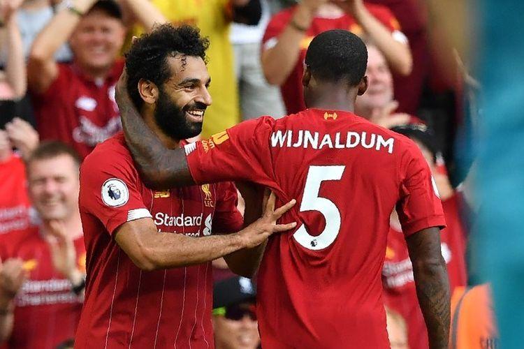 Mohamed Salah merayakan golnya bersama Georgionio Wijnaldum pada pertandingan Liverpool vs Arsenal dalam lanjutan Liga Inggris di Stadion Anfield, 24 Agustus 2019.