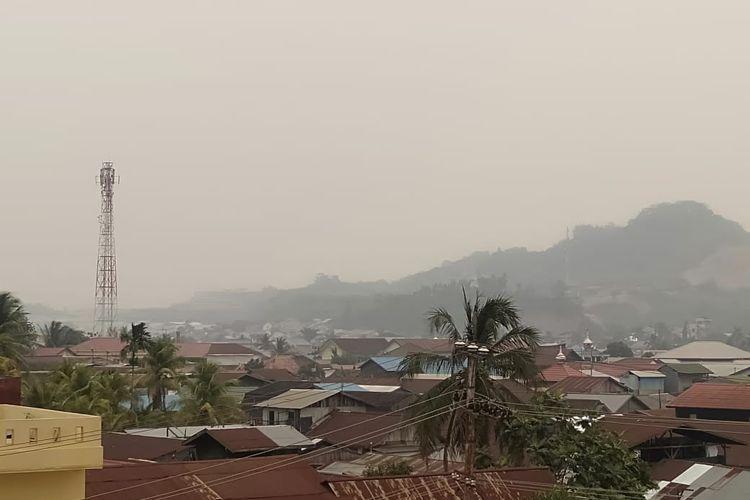 Asap pekat di langit Kota Samarinda, Sabtu (14/9/2019).