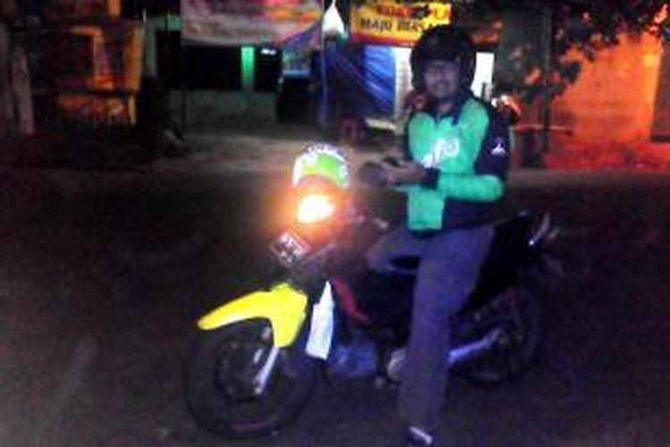Faridz Budhi Surya Kusuma (33), mantan manajer sebuah resort yang beralih profesi sebagai rider Go-Jek.