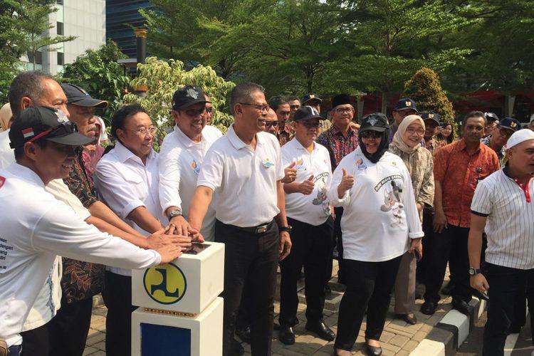 Menteri PUPR Basuki Hadimuljono saat melepas rombongan mudik bareng di halaman Gedung Utama Kementerian PUPR, Jumat (31/5/2019).