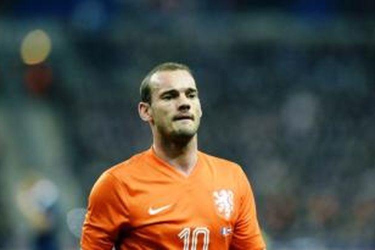 Pemain Belanda Wesley Sneijder bereaksi saat pertandingan persahabatan antara Belanda dan Perancis di Stade de France di Saint-Denis, Perancis pada 5 Maret 2014.