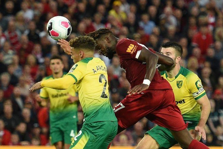 Divock Origi mencetak gol melalui sundulan pada pertandingan Liverpool vs Norwich City di Stadion Anfield dalam pekan pertama Liga Inggris 2019-2020, 9 Agustus 2019.